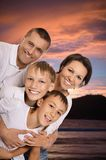 Cheerful family in the sunset together Stock Photos