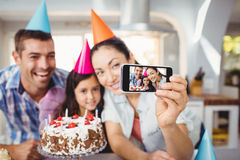Cheerful family taking selfie during birthday celebration Stock Photography