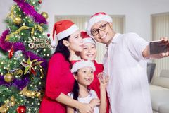 Cheerful family taking selfie on Christmas day Stock Image