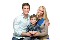 Cheerful family of three enjoying time together Stock Photo