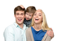 Cheerful family of three having fun Royalty Free Stock Photos