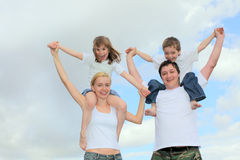 Cheerful family with two children Royalty Free Stock Photography