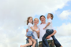 Cheerful family with two children Stock Photos