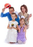 Cheerful family with two daughters holding various Stock Photo