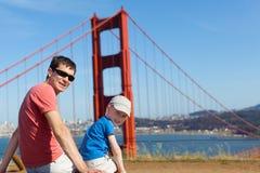 Cheerful family of two enjoying golden gate bridge in san franci Stock Photo