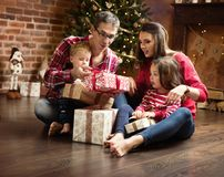 Cheerful family unboxing presents together stock photos