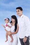 Cheerful family under blue sky Royalty Free Stock Images