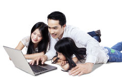 Cheerful family use notebook in studio Stock Photos