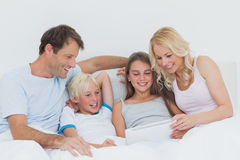 Cheerful family using digital tablet Stock Image