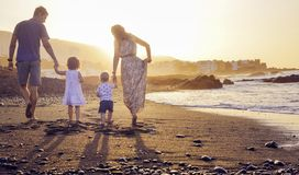 Cheerful family walking on the tropical beach stock photos