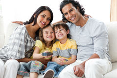 Cheerful family watching TV  together Stock Photo