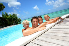 Cheerful family in water Stock Images