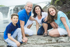 Cheerful family in waterfall area portrait. A Cheerful family in waterfall area portrait Stock Photos