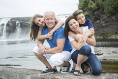 Cheerful family in waterfall area portrait. A Cheerful family in waterfall area portrait Royalty Free Stock Images