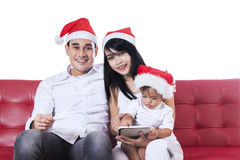 Cheerful family wearing christmas hat Royalty Free Stock Photography