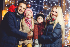 Cheerful family on winter evening Royalty Free Stock Image
