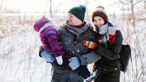 Cheerful family in the winter forest Stock Photography