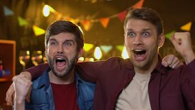 Cheerful fan friends watching sport championship in bar, celebrating team goal. Stock footage stock video footage