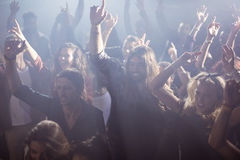 Cheerful fans dancing at nightclub during music festival Royalty Free Stock Image