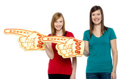Cheerful fans pointing the big foam hand sideways Royalty Free Stock Images