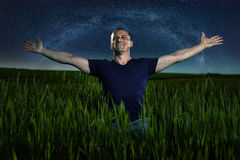 Cheerful farmer under the stars Royalty Free Stock Images