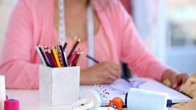 Cheerful fashion designer sketching stock video