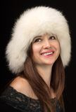 Cheerful fashion girl wears white fur hat Stock Images