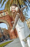 Cheerful fashion-monger in Barcelona, Spain walking on parapet Royalty Free Stock Photo