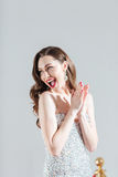 Cheerful fashion woman clapping hands Stock Photo