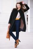 Cheerful fashion woman. Street style Stock Photos