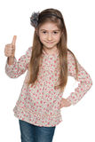 Cheerful fashion young girl holds her thumbs up Stock Photography