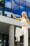 Cheerful fashionable woman in city royalty free stock images
