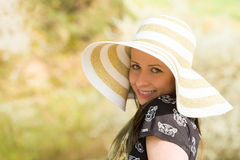 Cheerful fashionable woman in stylish hat and frock posing Royalty Free Stock Photos