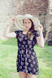 Cheerful fashionable woman in stylish hat and frock posing Stock Images