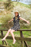 Cheerful fashionable woman in stylish hat and frock posing Royalty Free Stock Images