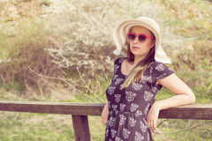 Cheerful fashionable woman in stylish hat, frock and sunglasses Royalty Free Stock Photography