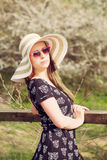 Cheerful fashionable woman in stylish hat, frock and sunglasses Royalty Free Stock Image