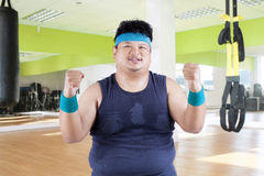 Cheerful fat man in fitness center Stock Photo