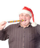 Cheerful fat man in Santa hat. Cheerful obese man in a red Santa hat chewing on a long colourful spiral lollipop with a grin on his face isolated on white Royalty Free Stock Photo