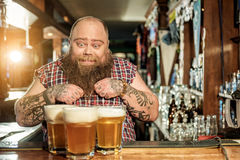 Cheerful fat man wants drink alcohol Royalty Free Stock Photo
