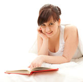 Cheerful fat student woman with book Stock Photo