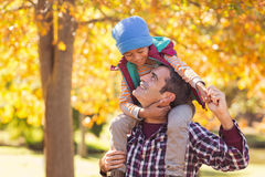 Cheerful father carrying son on shoulder at park Royalty Free Stock Photo