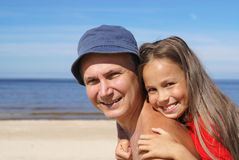 Cheerful father and daughter stock photo