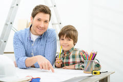 Cheerful father and daughter making  project Stock Images