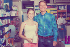 Cheerful father with daughter in pharmacy Royalty Free Stock Image
