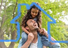 Cheerful father giving piggyback ride to her daughter against house outline Royalty Free Stock Photos