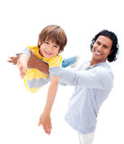 Cheerful father having fun with his son. Against a white background Stock Image