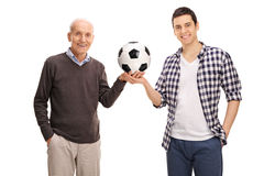 Cheerful father and son posing with a football Royalty Free Stock Images