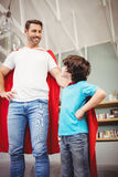 Cheerful father and son in superhero costume Stock Photography
