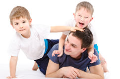 Cheerful father and sons Royalty Free Stock Photos